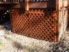 Shed hidden behind lattice doors