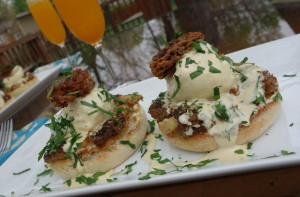 Triple Morel Eggs Benedict, served with fresh juice Mimosas, of course.